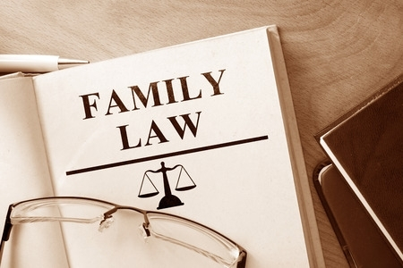 family-law-attorney - 43431120 - book with words family law and glasses.